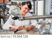 Купить «Technician in a dental lab or workshop working under a microscope», фото № 19564126, снято 20 января 2019 г. (c) easy Fotostock / Фотобанк Лори