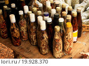 Купить «Display of bottles with Mama Juana in small vill», фото № 19928370, снято 19 сентября 2018 г. (c) easy Fotostock / Фотобанк Лори