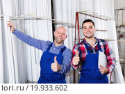 Workers posing in PVC shop. Стоковое фото, фотограф Яков Филимонов / Фотобанк Лори