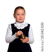 Купить «Young school girl ringing a golden bell on white background», фото № 20042030, снято 25 июня 2019 г. (c) easy Fotostock / Фотобанк Лори