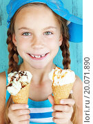 Купить «Portrait of 7 years old kid girl eating tasty ice cream over blue», фото № 20071890, снято 5 ноября 2013 г. (c) easy Fotostock / Фотобанк Лори