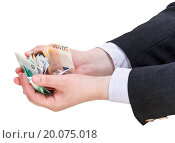 pile of euro banknotes in businessman handful. Стоковое фото, фотограф Zoonar/Valery Voenny / easy Fotostock / Фотобанк Лори