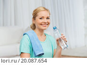 Купить «happy woman drinking water and exercising at home», фото № 20087654, снято 27 ноября 2015 г. (c) Syda Productions / Фотобанк Лори