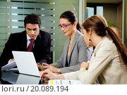 Купить «People at work: business team having a meeting», фото № 20089194, снято 25 июня 2007 г. (c) easy Fotostock / Фотобанк Лори