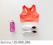 Купить «close up of female sports clothing and bottle set», фото № 20089286, снято 15 октября 2015 г. (c) Syda Productions / Фотобанк Лори