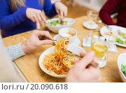 Купить «close up man eating pasta for dinner at restaurant», фото № 20090618, снято 26 ноября 2014 г. (c) Syda Productions / Фотобанк Лори