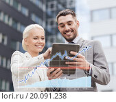 Купить «smiling businessmen with tablet pc outdoors», фото № 20091238, снято 19 августа 2014 г. (c) Syda Productions / Фотобанк Лори