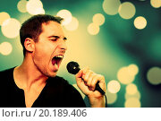 Купить «Retro image of man singing into microphone», фото № 20189406, снято 12 ноября 2012 г. (c) easy Fotostock / Фотобанк Лори