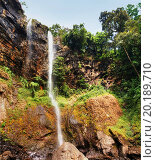 Купить «XXL Beautiful sacred waterfall with colonial observation deck deep into the thick and lush african tropical forest, great nature background.», фото № 20189710, снято 31 января 2013 г. (c) easy Fotostock / Фотобанк Лори