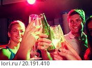 Купить «smiling friends with wine glasses and beer in club», фото № 20191410, снято 20 октября 2014 г. (c) Syda Productions / Фотобанк Лори