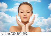 Купить «young woman face and hands over blue sky», фото № 20191902, снято 31 октября 2015 г. (c) Syda Productions / Фотобанк Лори