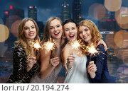 Купить «happy young women dancing at night club disco», фото № 20194274, снято 21 ноября 2015 г. (c) Syda Productions / Фотобанк Лори