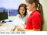 Купить «school girl with notebook and teacher in classroom», фото № 20194786, снято 15 ноября 2014 г. (c) Syda Productions / Фотобанк Лори