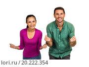 Triumphant couple raising fists. Стоковое фото, агентство Wavebreak Media / Фотобанк Лори
