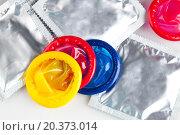 Купить «Разноцветные презервативы», фото № 20373014, снято 15 января 2016 г. (c) safonovstudio / Фотобанк Лори