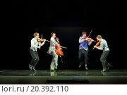Купить «MOSCOW - MAR 12, 2014: Four funny actor Taper-show: dancing on the strings jumping with musical instruments on stage of the Palace on Yauza», фото № 20392110, снято 12 марта 2014 г. (c) Losevsky Pavel / Фотобанк Лори
