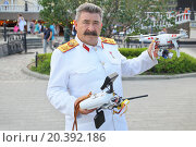 MOSCOW - AUG 12, 2014: Costumed Stalin in parade uniform of Marshal with quadcopter in hands at the Manege Square. Редакционное фото, фотограф Losevsky Pavel / Фотобанк Лори