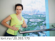 Купить «young woman standing on top floor of tall building against window», фото № 20393170, снято 9 мая 2014 г. (c) Losevsky Pavel / Фотобанк Лори