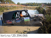 Купить «RUSSIA, PUSHKINO – 20 SEP, 2014: Off-road vehicle with driver is getting stuck on the water at Rainforest Challenge Russia Autumn 2014 PRO-X.», фото № 20394066, снято 20 сентября 2014 г. (c) Losevsky Pavel / Фотобанк Лори
