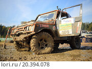 Купить «RUSSIA, PUSHKINO – 20 SEP, 2014: Off-road vehicle is standing with open door at Rainforest Challenge Russia Autumn 2014 PRO-X.», фото № 20394078, снято 20 сентября 2014 г. (c) Losevsky Pavel / Фотобанк Лори