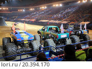 Купить «MOSCOW, RUSSIA - MAR 29, 2014: Big jeeps with huge wheels at show Monster X Tour in Olympic Sports Complex», фото № 20394170, снято 29 марта 2014 г. (c) Losevsky Pavel / Фотобанк Лори