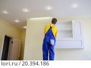 Купить «male furniture adjuster in uniform hang wall drawer», фото № 20394186, снято 9 июля 2014 г. (c) Losevsky Pavel / Фотобанк Лори