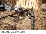 Купить «machine gun, rifle and ammunition in the trenches», фото № 20394210, снято 12 июля 2014 г. (c) Losevsky Pavel / Фотобанк Лори