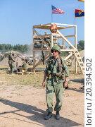 Купить «NELIDOVO, RUSSIA- JULY 12, 2014: Battlefield 2014: GI on a background of the observation tower with flags», фото № 20394502, снято 12 июля 2014 г. (c) Losevsky Pavel / Фотобанк Лори