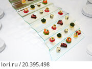 Купить «Set of delicious Japanese sushi rolls on the glass stairs.», фото № 20395498, снято 4 декабря 2014 г. (c) Losevsky Pavel / Фотобанк Лори