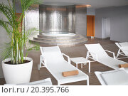 Купить «SOCHI, RUSSIA - JUL 27, 2014: The room with a round whirlpool and loungers in Hotel Radisson Blu Paradise Resort and Spa», фото № 20395766, снято 27 июля 2014 г. (c) Losevsky Pavel / Фотобанк Лори