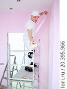 Купить «Plasterer sticks masking tape in corner near ceiling», фото № 20395966, снято 30 марта 2014 г. (c) Losevsky Pavel / Фотобанк Лори