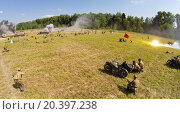 Купить «RUSSIA, NELIDOVO - JUL 12, 2014: German troops fight in trenches with Red army during reconstruction Battlefield at Second World War. Aerial view. (Photo with noise from action camera)», фото № 20397238, снято 12 июля 2014 г. (c) Losevsky Pavel / Фотобанк Лори