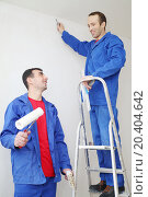 Купить «Happy workers in blue with construction tools, stand on ladder and look at each other in new apartment», фото № 20404642, снято 11 декабря 2013 г. (c) Losevsky Pavel / Фотобанк Лори