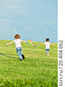 Купить «Little girl and boy run on meadow to fly kite, rear view, focus on girl», фото № 20404662, снято 9 июня 2013 г. (c) Losevsky Pavel / Фотобанк Лори