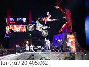 Купить «MOSCOW - MAR 02: Jump on a motorcycle on the festival extreme sports Breakthrough 2013 in the arena of the Olympic Sports Complex, on March 02, 2013 in Moscow, Russia.», фото № 20405062, снято 2 марта 2013 г. (c) Losevsky Pavel / Фотобанк Лори