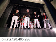 Купить «A group of eleven people in the same costumes rehearsing with the drums on stage», фото № 20405286, снято 26 сентября 2013 г. (c) Losevsky Pavel / Фотобанк Лори