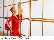 Купить «Beautiful woman in red Andalusian costume poses with shawls», фото № 20405402, снято 7 мая 2014 г. (c) Losevsky Pavel / Фотобанк Лори