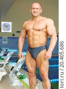 Купить «Happy sunburnt bodybuilder stands near indoor pool before swimming in gym hall», фото № 20405686, снято 8 мая 2014 г. (c) Losevsky Pavel / Фотобанк Лори