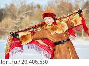Купить «Portrait of smiling young woman in sheepskin short fur coat with colored shawl behind her back against a winter forest», фото № 20406550, снято 17 января 2014 г. (c) Losevsky Pavel / Фотобанк Лори