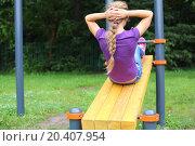 Купить «A young girl doing abdominal crunches», фото № 20407954, снято 4 августа 2013 г. (c) Losevsky Pavel / Фотобанк Лори