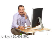 Купить «Manager holding serious talks on a mobile phone», фото № 20408502, снято 7 июня 2014 г. (c) Losevsky Pavel / Фотобанк Лори