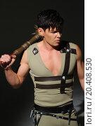Купить «Strong young man in a costume put mace on his shoulder», фото № 20408530, снято 14 апреля 2014 г. (c) Losevsky Pavel / Фотобанк Лори