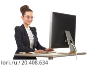 Купить «Beautiful girl sitting at table and stares at computer screen», фото № 20408634, снято 7 июня 2014 г. (c) Losevsky Pavel / Фотобанк Лори