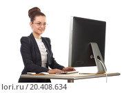 Купить «Beautiful girl sitting at table and stares at computer screen», фото № 20408634, снято 7 июня 2014 г. (c) Losevsky Pavel / Фотобанк Лори