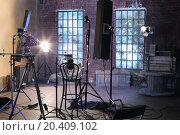 Купить «Studio with studio with brick walls and ragged windows, spotlights, camera with special devices for shooting video.», фото № 20409102, снято 21 февраля 2013 г. (c) Losevsky Pavel / Фотобанк Лори
