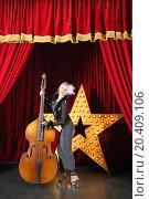 Купить «Beautiful woman in pop dress playing with contrabass on stage at music hall», фото № 20409106, снято 19 апреля 2014 г. (c) Losevsky Pavel / Фотобанк Лори