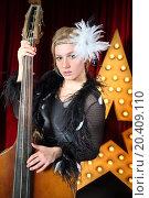 Купить «Portrait of beautiful girl in pop suit with contrabass», фото № 20409110, снято 19 апреля 2014 г. (c) Losevsky Pavel / Фотобанк Лори