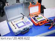 Купить «MOSCOW, RUSSIA - DEC 4, 2013: Device for control of high voltage switches and Milliohmmeter at Exhibition Electrical Networks of Russia - 2013 in exhibition center MosExpo (VVC).», фото № 20409622, снято 4 декабря 2013 г. (c) Losevsky Pavel / Фотобанк Лори