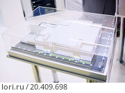 Купить «MOSCOW, RUSSIA - DEC 4, 2013: Architectural model of building of electrical substation at Exhibition Electrical Networks of Russia - 2013 in exhibition center MosExpo (VVC).», фото № 20409698, снято 4 декабря 2013 г. (c) Losevsky Pavel / Фотобанк Лори