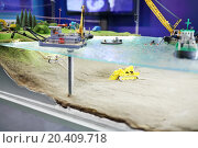 Купить «Small model of cable laying process under water of lake by underwater excavator, ships and divers», фото № 20409718, снято 4 декабря 2013 г. (c) Losevsky Pavel / Фотобанк Лори